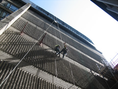 professional industrial abseilers installing scaffolding brackets for high-rise scaffolding
